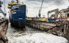 Former oil supply vessel converted into fish feed carrier